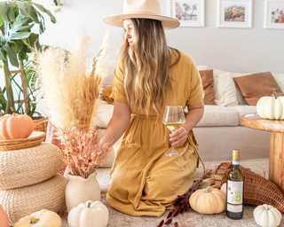 Pro tip: KRIS Pinot Grigio makes the perfect sidekick while decorating for fall. #KRISwine