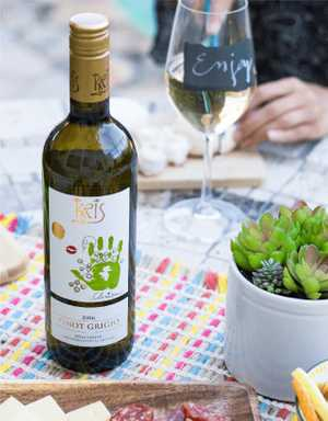 KRIS Pinot Grigio being enjoyed in a picnic setting.